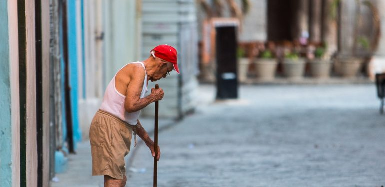 Old man sweeping in Havana